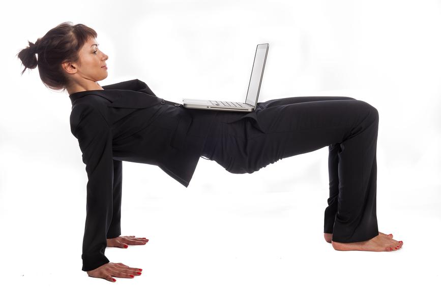 Woman doing Yoga at Work.