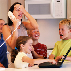 Frustrated mother with children on phone