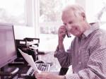 42109256 - senior man working at home